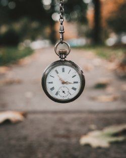 Pocket watch infront of property